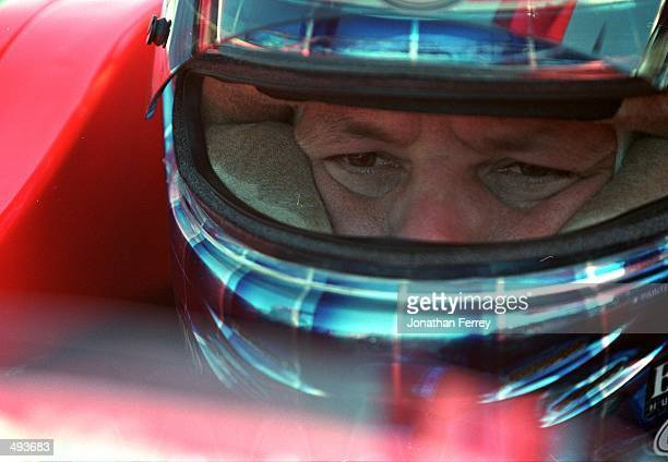 Driver Mauricio Gugelmin of Brazil who drives a Mercedes Reynard 99I for Pacwest Racing looks on from his car during the Grand Prix of Monterey part...
