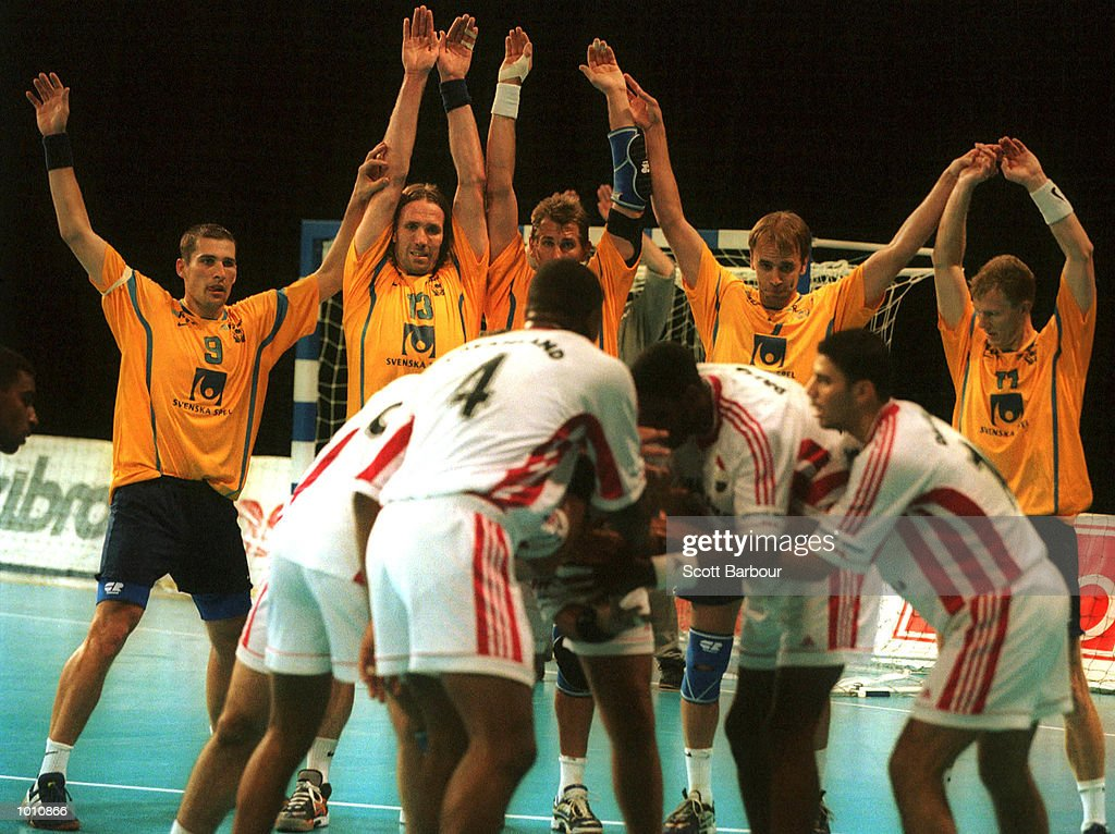 12 Sep 1999. Egyptian players prepare to take the last shot of the game from a penalty as they try to tie the game, as the Sweden team defend during the match as Sweden defeated Egypt 31-30 at the Southern Cross International Handball Challenge, a SOCOG Olympic test event, Buring Pavilion, Olympic Park Homebush, Sydney, Australia. Mandatory Credit: Scott Barbour/ALLSPORT