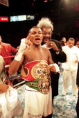 Felix Trinidad celebrates with promoter Don King after defeating Oscar De La Hoya by decision to win the welterweight title fight at the Mandalay Bay...