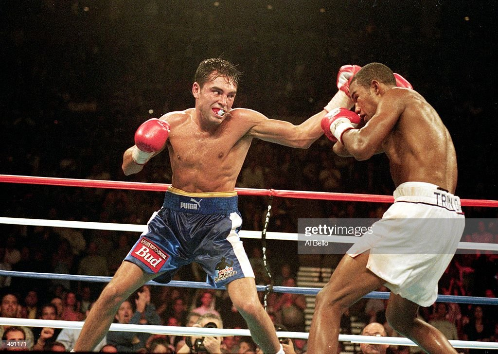 Felix Trinidad covers up as Oscar De La Hoya prepares to throw a right during the welterweight title fight at the Mandalay Bay Casino in Las Vegas...