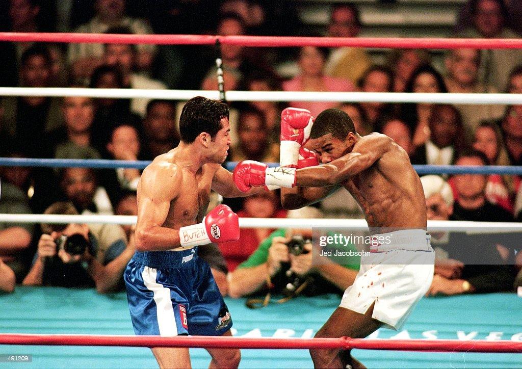 Felix Trinidad throws a left at Oscar De La Hoya during the welterweight title fight at the Mandalay Bay Casino in Las Vegas Nevada Trinidad won the...
