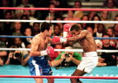 Felix Trinidad throws a left at Oscar De La Hoya during the welterweight title fight at the Mandalay Bay Casino in Las Vegas Nevada Trinidad won the...