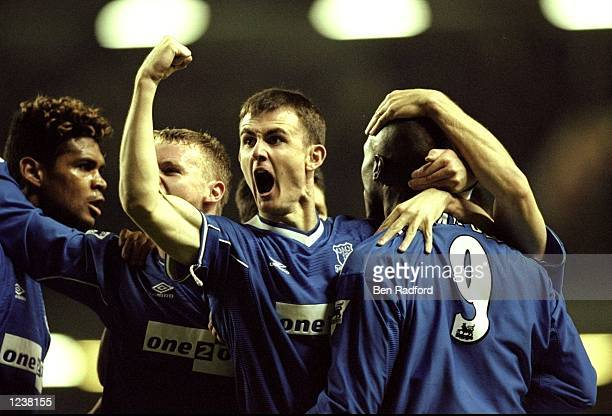 Francis Jeffers celebrates Kevin Campbell's 4th minute goal with Everton team mates during the FA Premier League match between Liverpool and Everton...