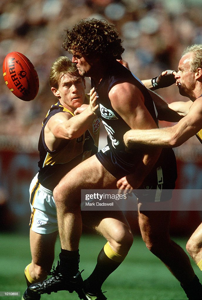 Fraser Brown #20 for Carlton attempts to break the tackle of Michael Braun #10 and Dean Kemp #2 for the West Coast Eagles, during the first semi final played at the MCG, Melbourne, Victoria, Australia. Carlton eliminated West Coast from thefinals series. Mandatory Credit: Mark Dadswell/ALLSPORT