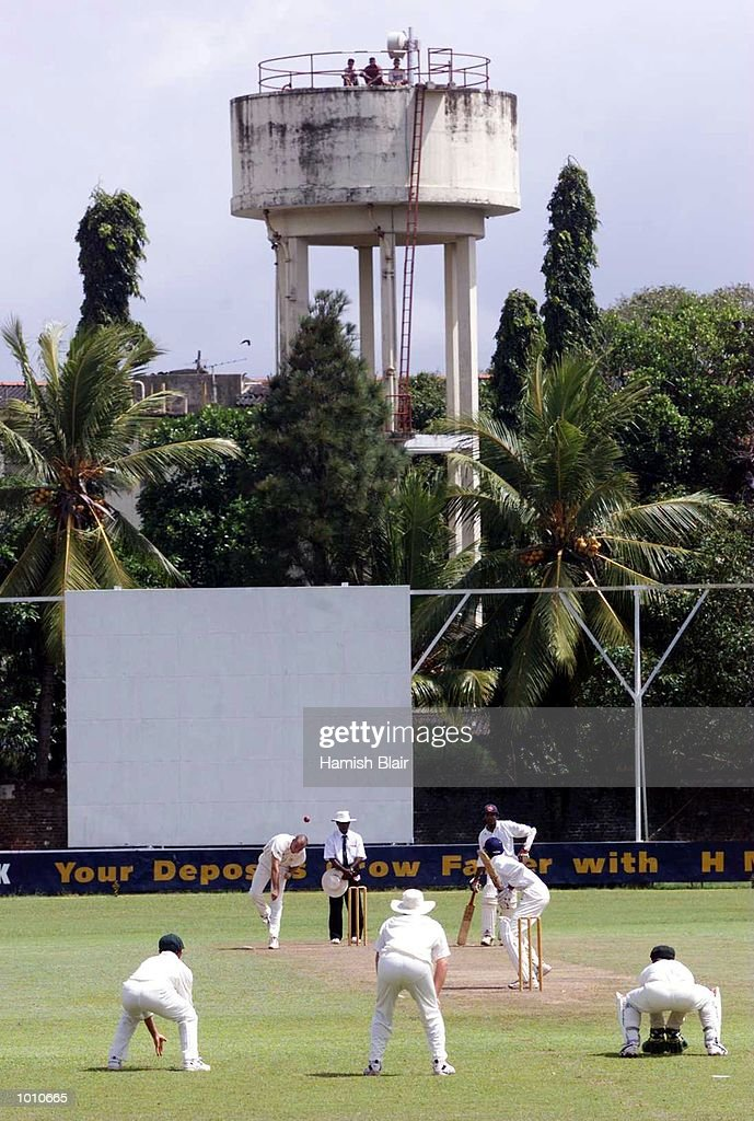 General view with spectators in water tower with Colin Miller of Australia bowling, during day three of the tour match between the Sri Lanka Board XI and Australia at Saravanamuttu Stadium, Colombo, Sri Lanka. Mandatory Credit: Hamish Blair/ALLSPORT