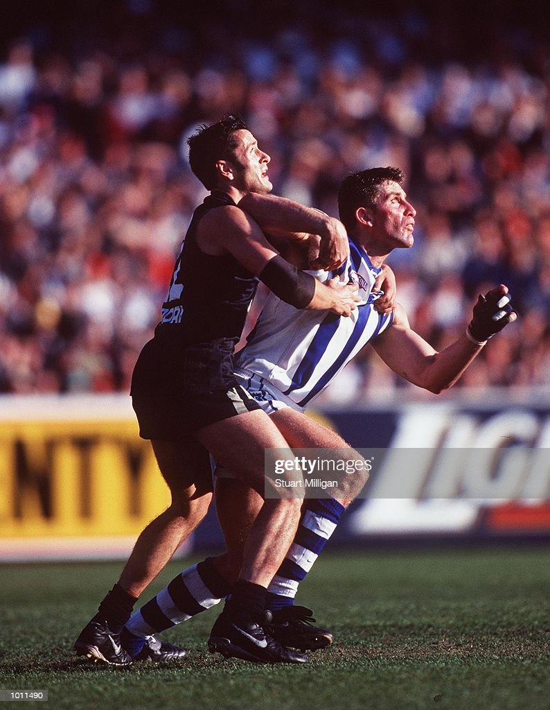 Glenn Manton #22 for Carlton holds Corey McKernan #31 for the Kangaroos, in the AFL Grand Final match between the Kangaroos and Carlton, played at the Melbourne Cricket Ground, Melbourne, Australia. The Kangaroos defeated Carlton. MandatoryCredit: Stuart Milligan/ALLSPORT