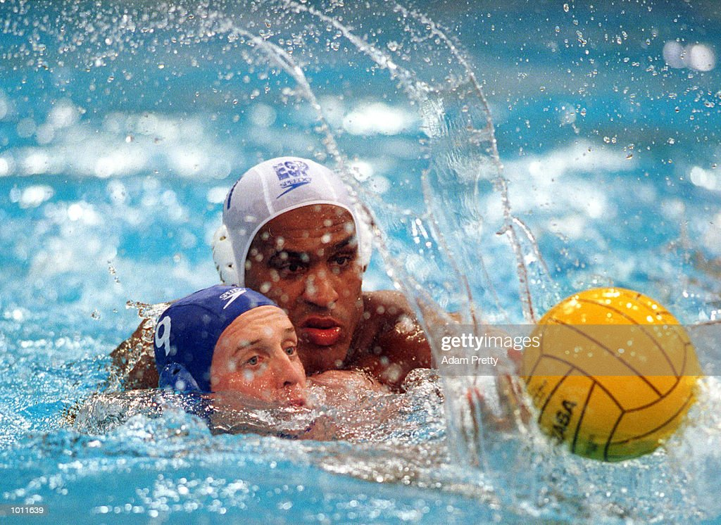 Grant Waterman of Australia is chased by Ivan Perez of Spain during the match between Australia v Spain in the Waterpolo World Cup at the Sydney International Aquatic Centre, Homebush, Sydney, Australia. Mandatory Credit: Adam Pretty/ALLSPORT