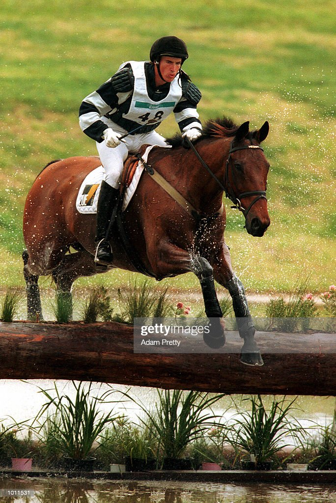 G.Wallace rides Happy Hill over jump 19 during the cross country race of the Sydney International Equestrian three day event at the Sydney International Equestrian centre Horsley Park,Sydney Australia.The is a SOCOG test event. Mandatory Credit: Adam Pretty/ALLSPORT