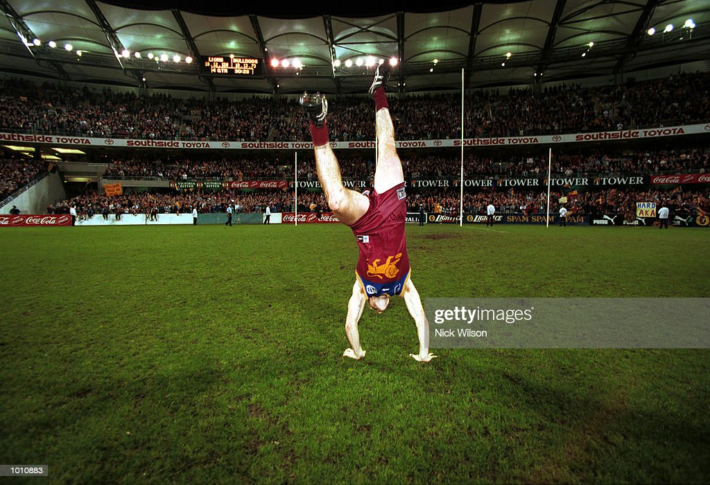 Jason Akermanis #12 of Brisbane celebrates the 2nd semi final win between the Brisbane Lions and the Western Bulldogs at the Gabba, Brisbane, Australia. Mandatory Credit: Nick Wilson/ALLSPORT