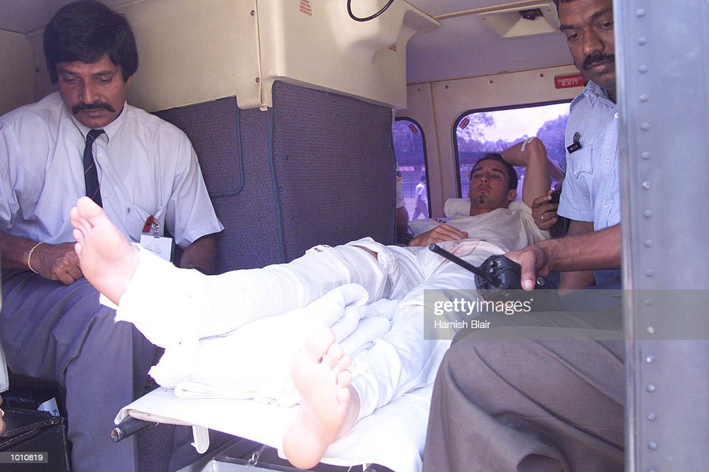 Jason Gillespie is loaded into a military helicopter to betaken to Colombo after injuring his ankle, Kandy, Sri Lanka. Mandatory Credit: Hamish Blair/ALLSPORT