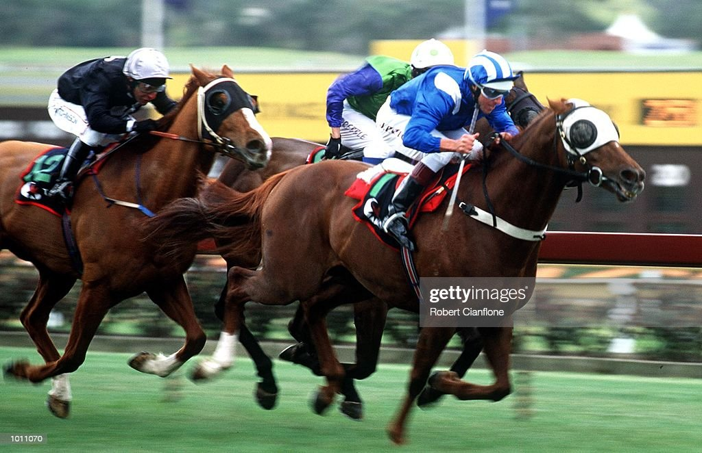 Jockey Jason Patton leads the pack in race five with his horse Ihtiyati, during the Morse Code Handicap at Sandown Raceway, Melbourne, Australia. Jason Patton went on to win the race. Mandatory Credit: Robert Cianflone/ALLSPORT