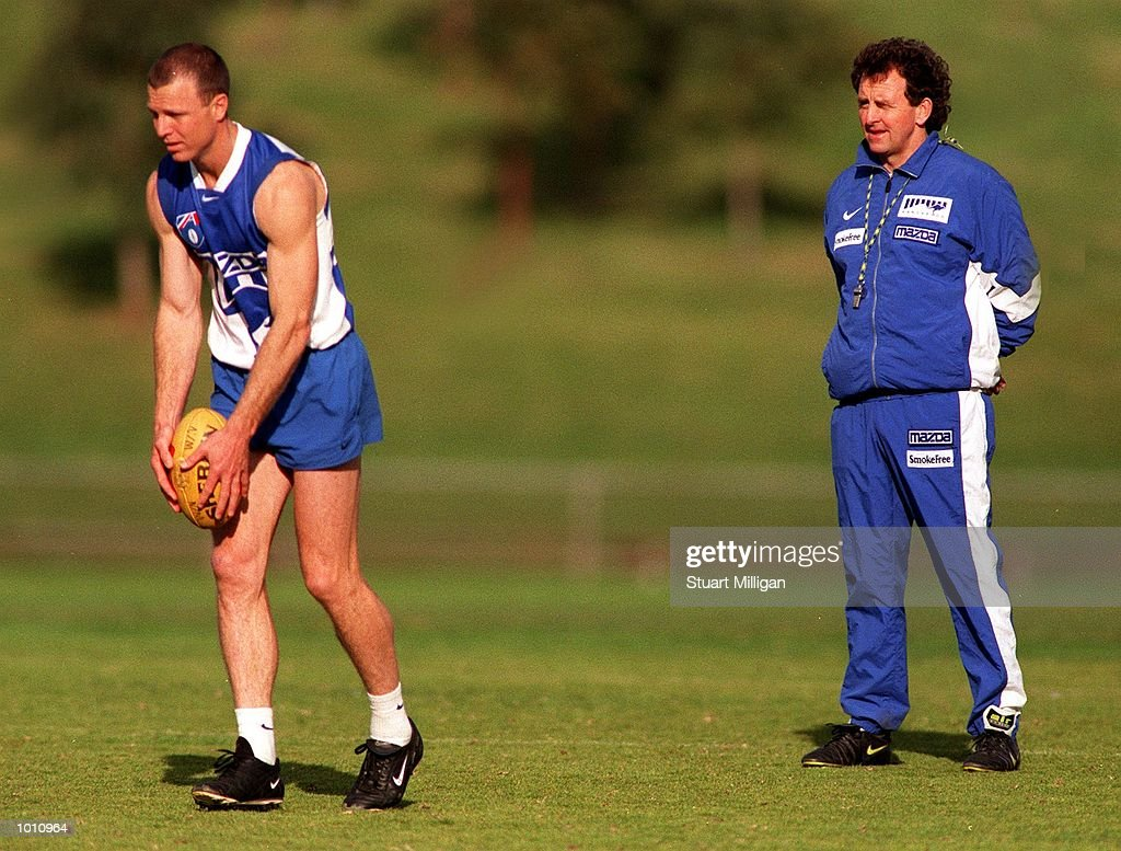 John Blakey,#12 for the Kangaroos has a kick at goal, while his coach Dennis Pagan, looks on during training at Arden Street Oval, Melbourne, Australia. Mandatory Credit: Stuart Milligan/ALLSPORT
