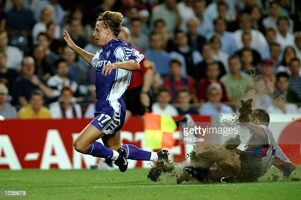 Jorg Heinrich of Fiorentina goes flying as Sergi Barjuan of Barcelona digs up half the pitch during the UEFA Champions League group B match at the...