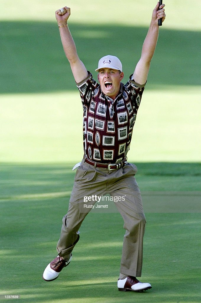 Justin Leonard of the USA celebrates holing a long birdie putt on the 17th green during the final day of the 33rd Ryder Cup at Brookline Country Club...