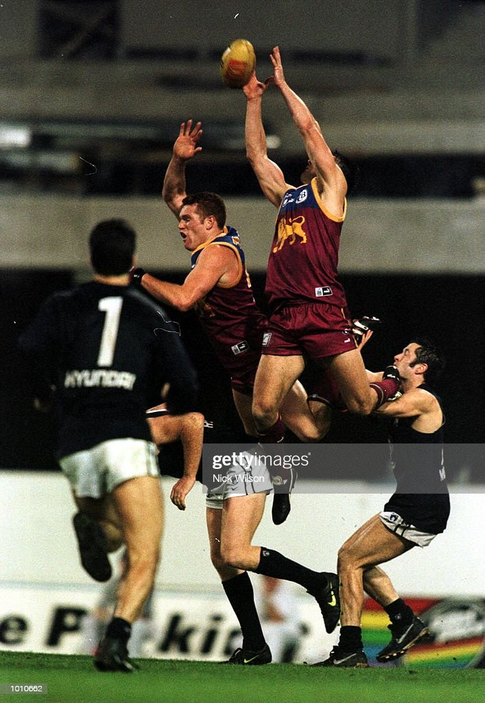 Justin Leppitsch and Alastair Lynch of Brisbane soar above Carlton players to take a mark during the second AFL qualifying final at The Gabba, Brisbane, Australia. Brisbane won the game 20.18.138 to 8.17.65. Mandatory Credit: Nick Wilson/ALLSPORT