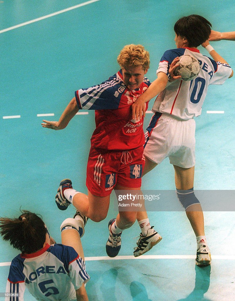 10 Sep 1999. K. Duvholt of Norway clashes with Y. Kim and S. Jang of Korea, during Norways win of 26 to 25 over Korea at the Southern Cross International Handball Challenge, a SOCOG Olympic test event, Buring Pavilion, Olympic Park Homebush Sydney Australia. Mandatory Credit: Adam Pretty/ALLSPORT
