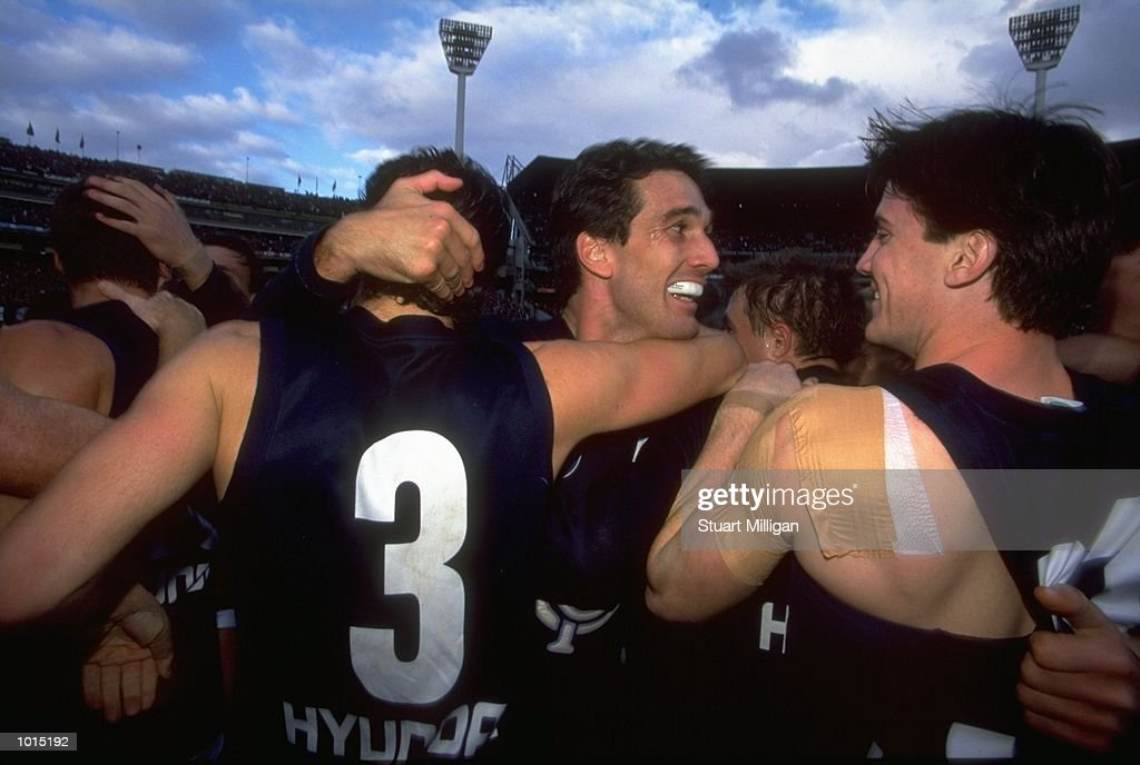 Kris Massie #3 and Stephen Silvagni of the Carlton Blues celebrate following the AFL Second Preliminary Final against the Essendon Bombers at the MCG in Melbourne, Australia. Carlton progressed to the Grand Final with a tense 104 - 103 win.\ Mandatory Credit: Stuart Milligan /Allsport