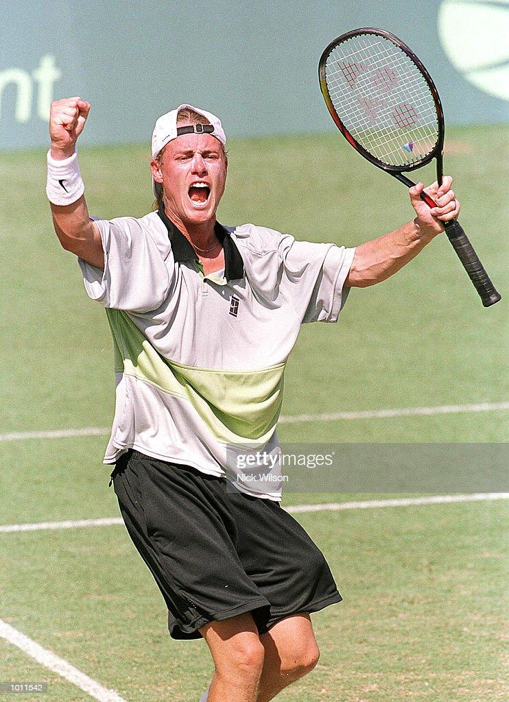 Lleyton Hewitt of Australia celebrates winning his singles match against Marat Safin of Russia 7-6, 6-2, 4-6, 6-3 during the Davis Cup semi final at the ANZ Stadium, Brisbane, Australia. Mandatory Credit: Nick Wilson/ALLSPORT