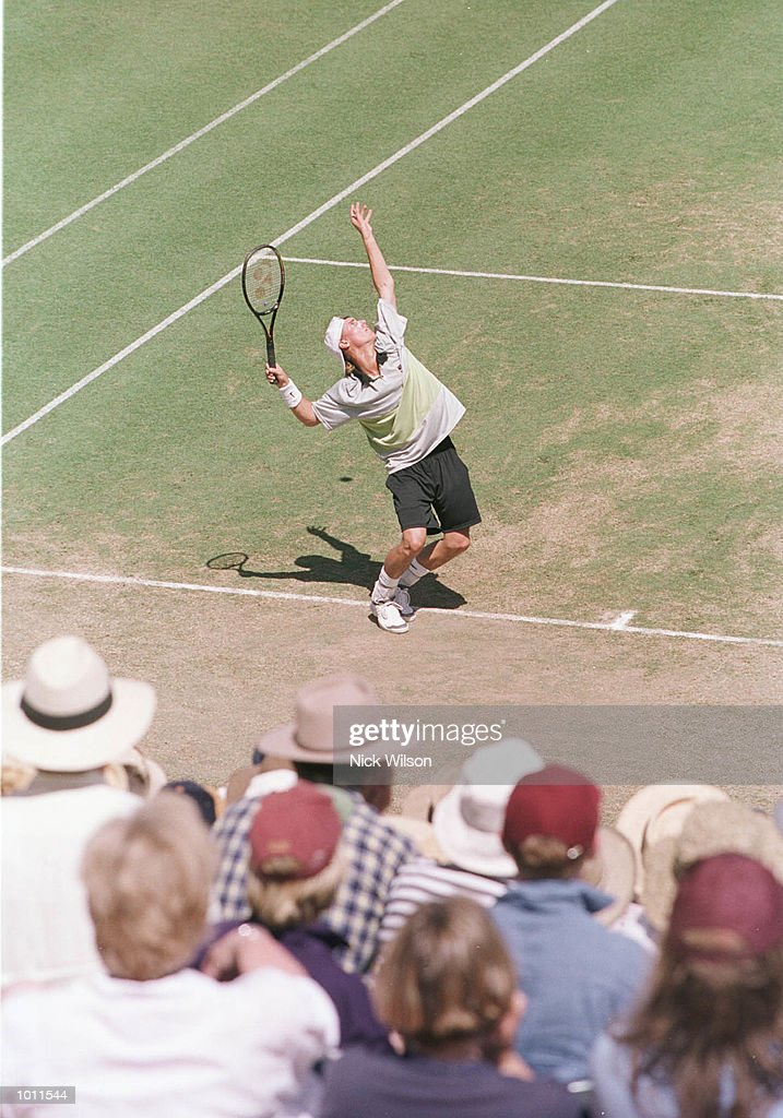 Lleyton Hewitt of Australia prepares to serve in front of a partisan crowd whilst winning his singles match against Marat Safin of Russia 7-6, 6-2, 4-6, 6-3 during the Davis Cup semi final at the ANZ Stadium, Brisbane, Australia. MandatoryCredit: Nick Wilson/ALLSPORT