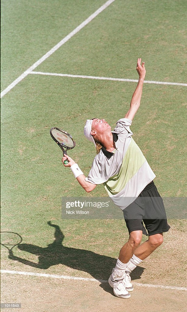 Lleyton Hewitt of Australia prepares to serve whilst winning his singles match against Marat Safin of Russia 7-6, 6-2, 4-6, 6-3 during the Davis Cup semi final at the ANZ Stadium, Brisbane, Australia. Mandatory Credit: Nick Wilson/ALLSPORT
