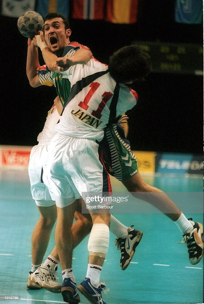 M. Slavujevic of Australia is being blocked by N.Abe of Japan during the match between Australia v Japan at the Southern Cross International Handball Challenge, at the Buring Pavilion, Sydney Olympic Park Homebush, Sydney Australia. Mandatory Credit: Scott Barbour/ALLSPORT