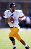Marc Bulger of the West Virginia Volunteers moves back to pass the ball during the game against the Maryland Terrapins at Byrd Stadium in College...