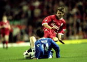 Michael Owen of Liverpool slides in with a two footed challenge on David Weir of Everton during the FA Premier League match between Liverpool and...