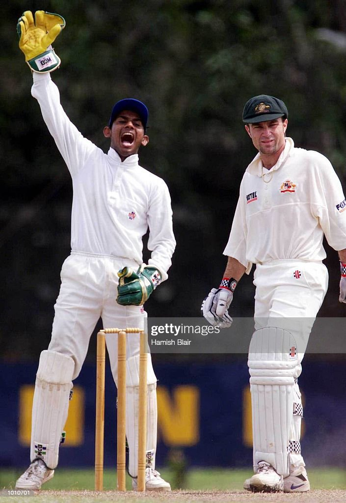 Michael Slater of Australia looks disinterested as Board XI wicketkeeper Prasanna Jayawardene loudly appeals, during day four of the tour match between the Sri Lanka Board XI and Australia at Saravanamuttu Stadium, Colombo, Sri Lanka. Mandatory Credit: Hamish Blair/ALLSPORT