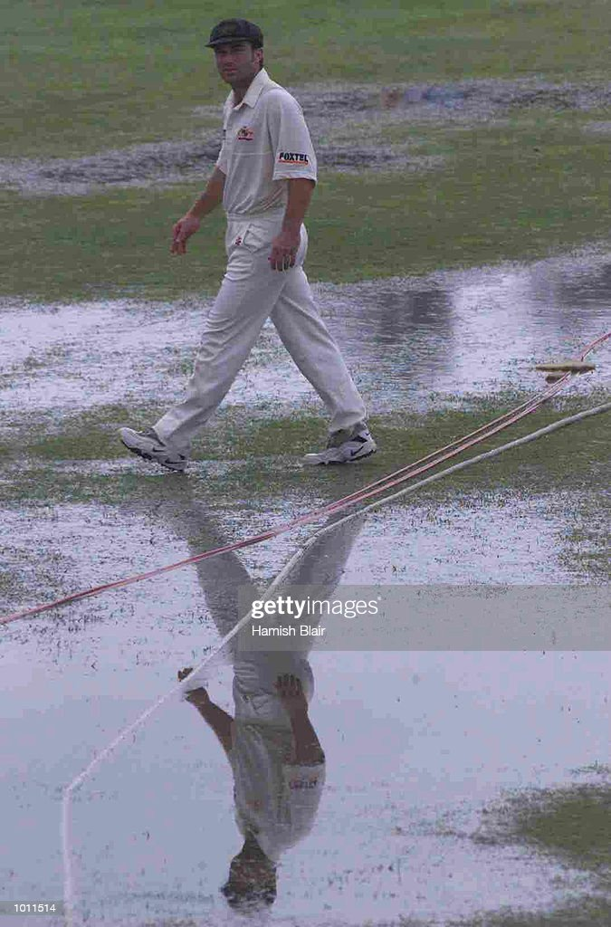 Michael Slater of Australia walks on the saturated ground, after rain ended play, during day five of the second test between Sri Lanka and Australia at Galle International Stadium, Galle, Sri Lanka.X Mandatory Credit: Hamish Blair/ALLSPORT