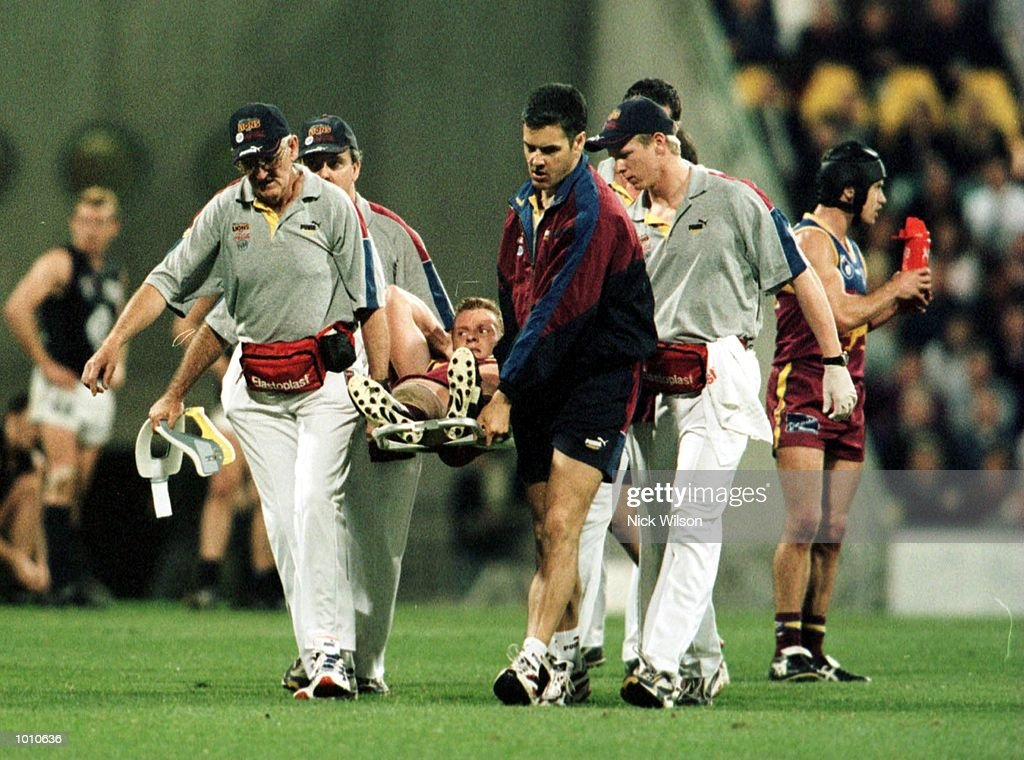 Michael Voss #3 of the Brisbane Lions is stretchered off injured against Carlton during the second AFL qualifying final at The Gabba, Brisbane, Australia. Mandatory Credit: Nick Wilson/ALLSPORT