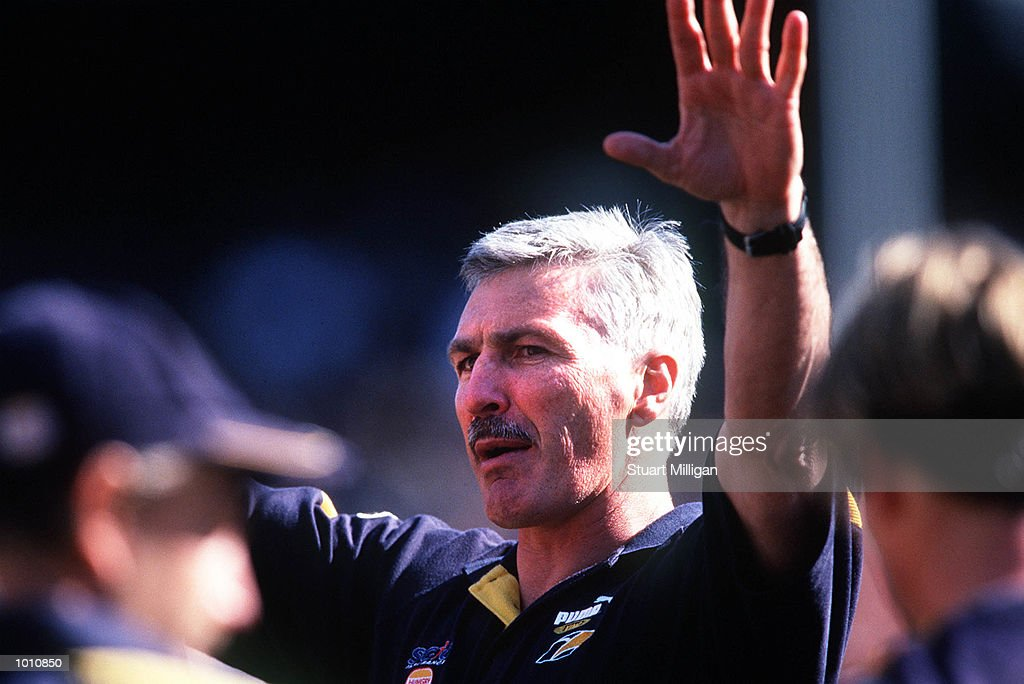 Mick Malthouse, coach of the West Coast Eagles addresses his players at three quarter time, during the first semi final played at the MCG, Melbourne, Victoria, Australia. Carlton eliminated West Coast from the finals series. Mandatory Credit: Stuart Milligan/ALLSPORT
