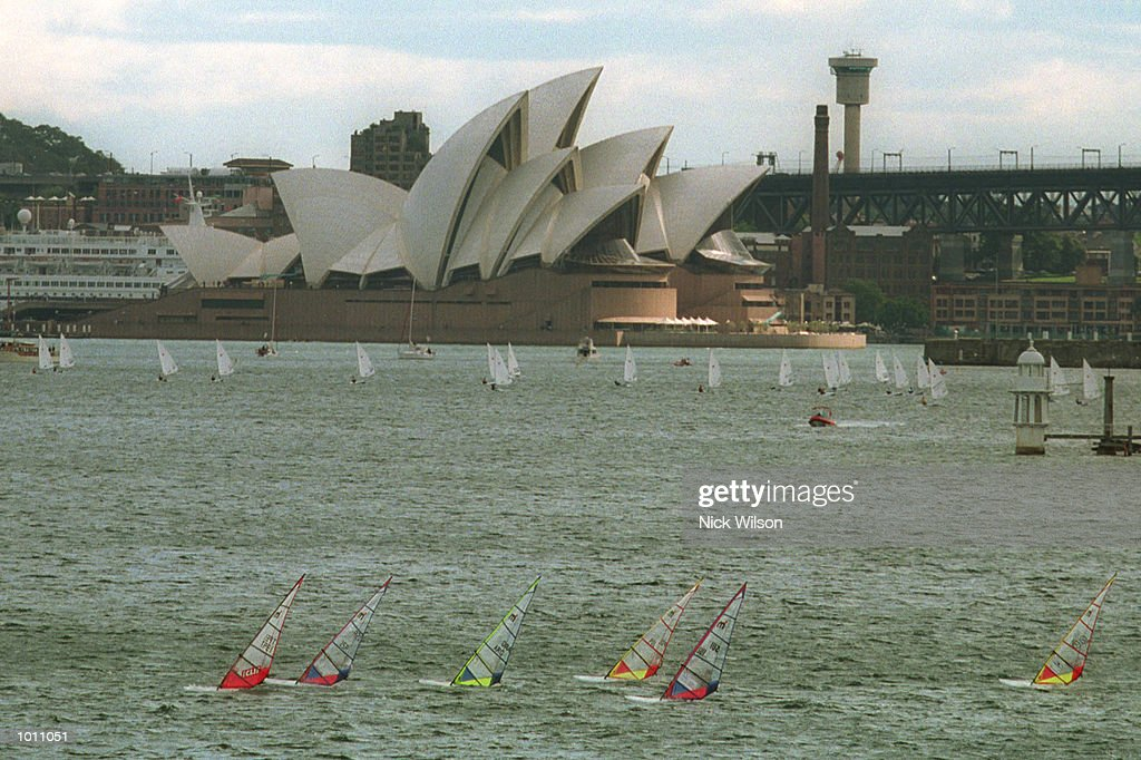 18 Sep 1999 Mistral class make theie way across the harbour with the Laser class competing in the background infront of the Sydney Opera House during the 1999 Sydney Harbour Regatta in Sydney Harbour, Sydney, Australia. Mandatory Credit: Nick Wilson/ALLSPORT