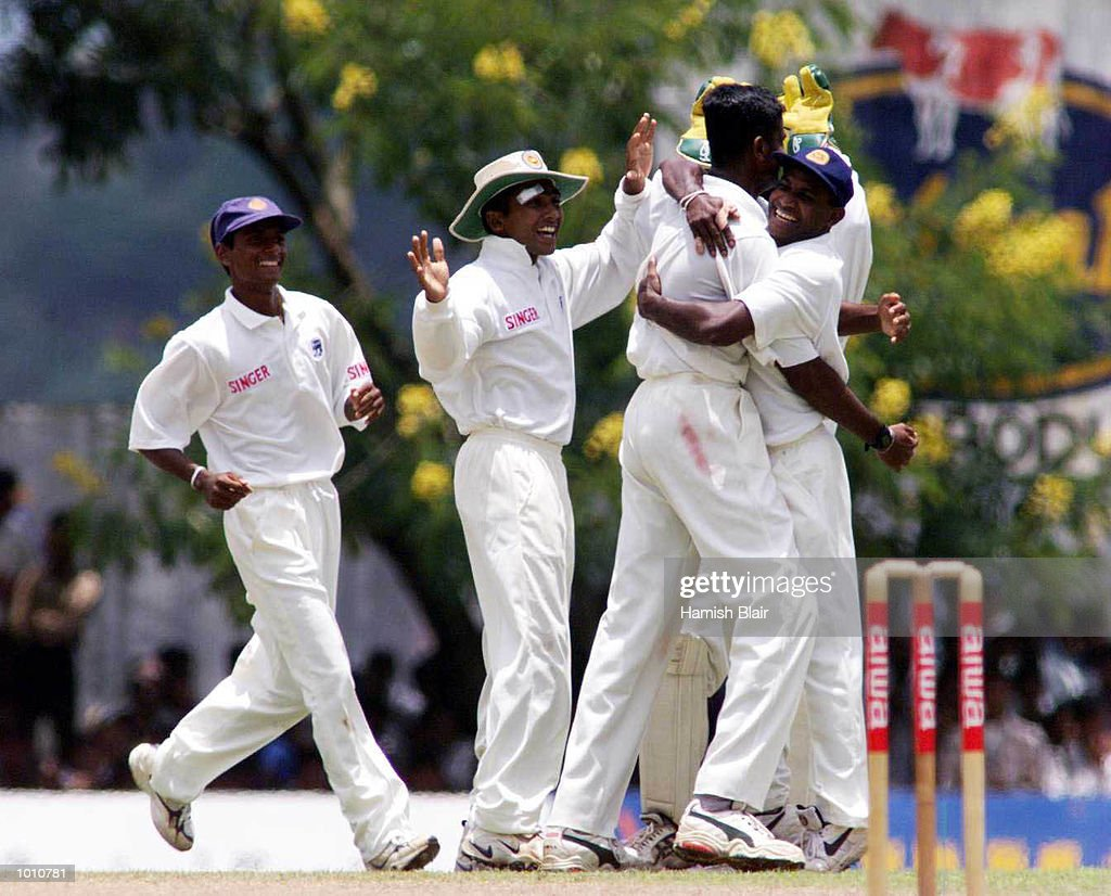 Nuwan Zoysa of Sri Lanka celebrates with team mates after Zoysa dismissed Warne, Romesh Kaluwitharana celebrates the wicket in background, during day one of the First Test between Sri Lanka and Australia at Asgiriya Stadium, Kandy, Sri Lanka. Mandatory Credit: Hamish Blair/ALLSPORT