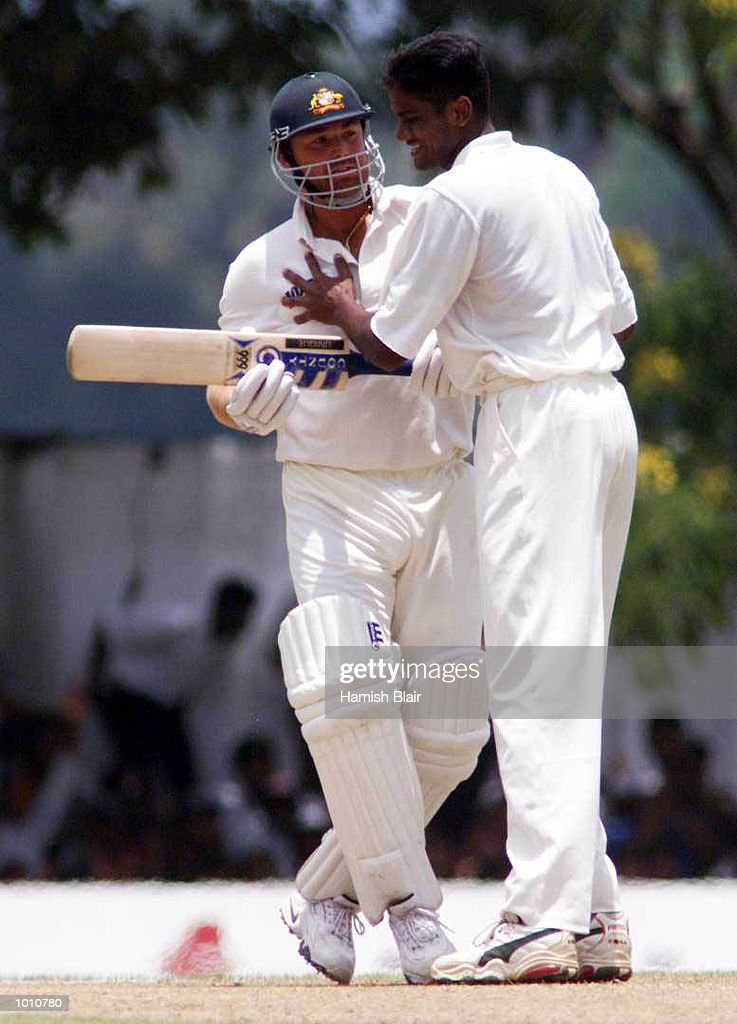 Nuwan Zoysa of Sri Lanka clashes with Shane Warne of Australia after Zoysa had dismissed Warne, during day one of the First Test between Sri Lanka and Australia at Asgiriya Stadium, Kandy, Sri Lanka. Mandatory Credit: Hamish Blair/ALLSPORT