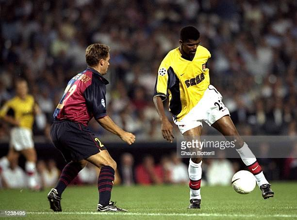 Nwankwo Kanu of Arsenal controls the ball under pressure from Frank de Boer of Barcelona during the Barcelona v Arsenal UEFA Champions League Group B...