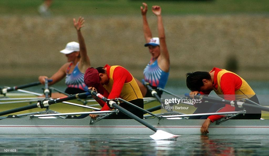 24 Sep 1999 Oxana Dorodonova & Larissa Merk of Russia celebrate winning gold, in foreground Lin Liu & xiuyun Zhang of China are exhausted after race in the Womens double sculls final at the Pacific Rim International Regatta - a S.O.C.O.G. test event atthe Sydney International Regatta Centre, Penrith, Sydney, Australia. Mandatory Credit: Scott Barbour/ALLSPORT