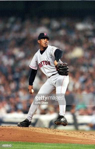 Pedro Martinez of the Boston Red Sox winds back to pitch the ball during a game against the New York Yankees at the Yankee Stadium in Bronx New York...