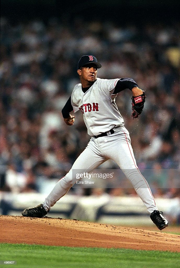 Pedro Martinez of the Boston Red Sox winds bak to pitch the ball during a game against the New York Yankees at the Yankee Stadium in Bronc New York...