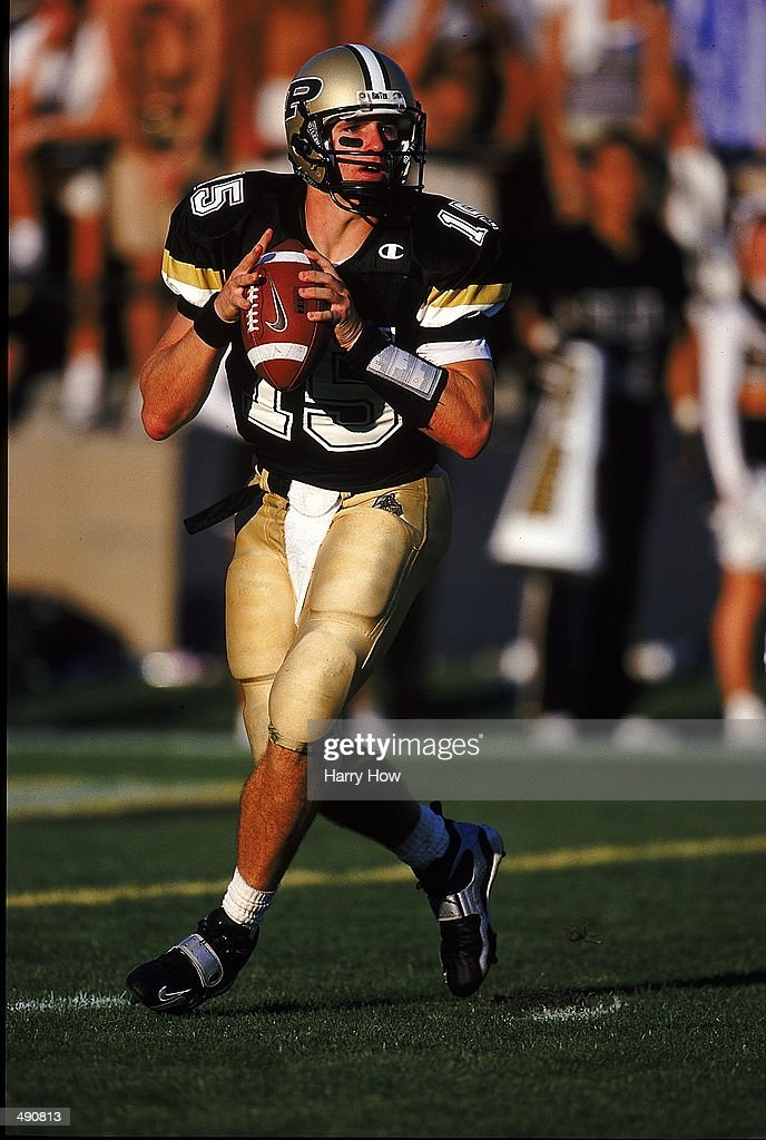 Quarterback Drew Brees of the Purdue Boilermakers moves to pass the ball during the game against the Notre Dame Fighting Irish at the RossAde Stadium...