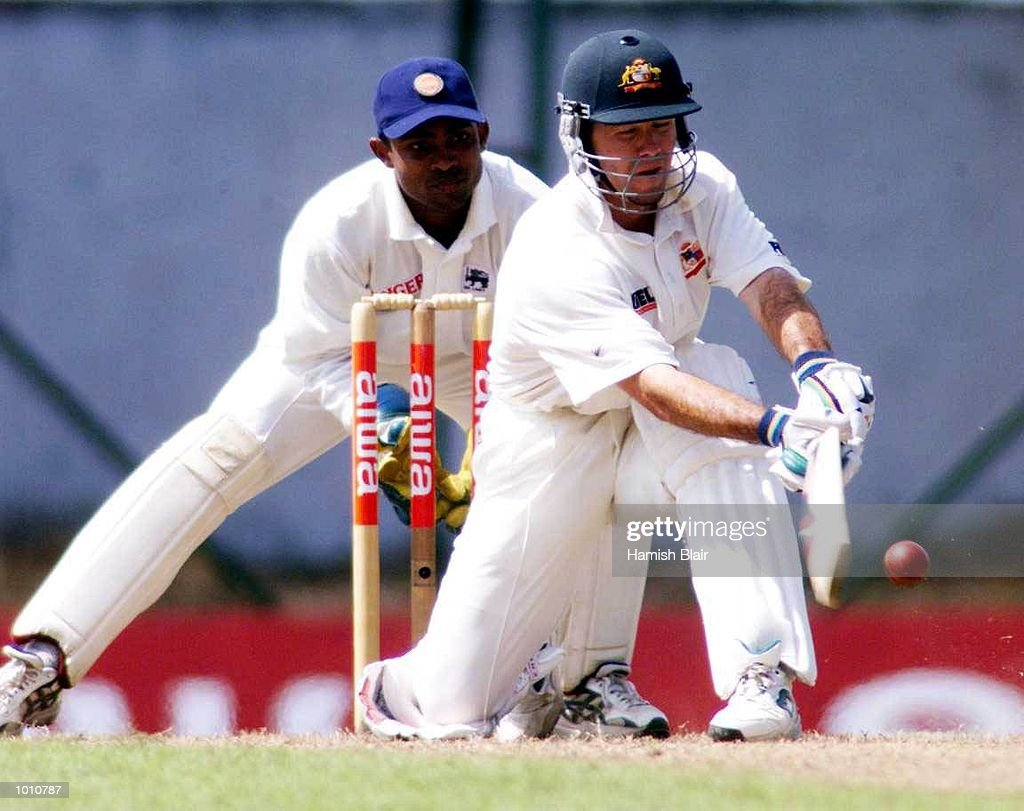 Ricky Ponting of Australia batting with Romesh Kaluwitharana of Sri Lanka looking on, during day one of the First Test between Sri Lanka and Australia at Asgiriya Stadium, Kandy, Sri Lanka. Mandatory Credit: Hamish Blair/ALLSPORT