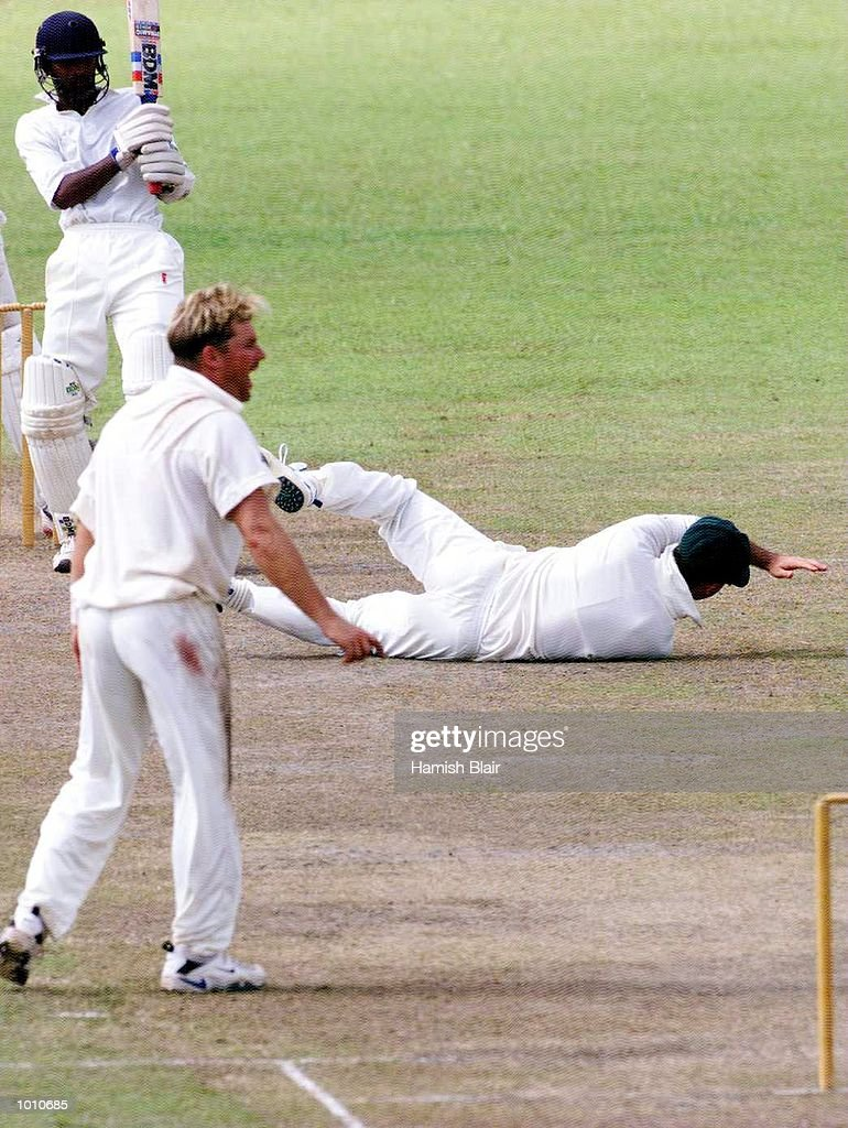 Ricky Ponting of Australia dives for a miraculous catch off Chamara Silva but it was given not out, as Shane Warne looks on, during day three of the tour match between the Sri Lanka Board XI and Australia at Saravanamuttu Stadium, Colombo, Sri Lanka. Mandatory Credit: Hamish Blair/ALLSPORT