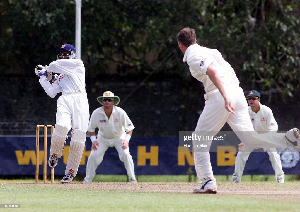 Russel Arnold of the Board XI hits Glenn McGrath of Australia for four, during day two of the tour match between the Sri Lanka Board XI and Australia at Saravanamuttu Stadium, Colombo, Sri Lanka. Mandatory Credit: Hamish Blair/ALLSPORT