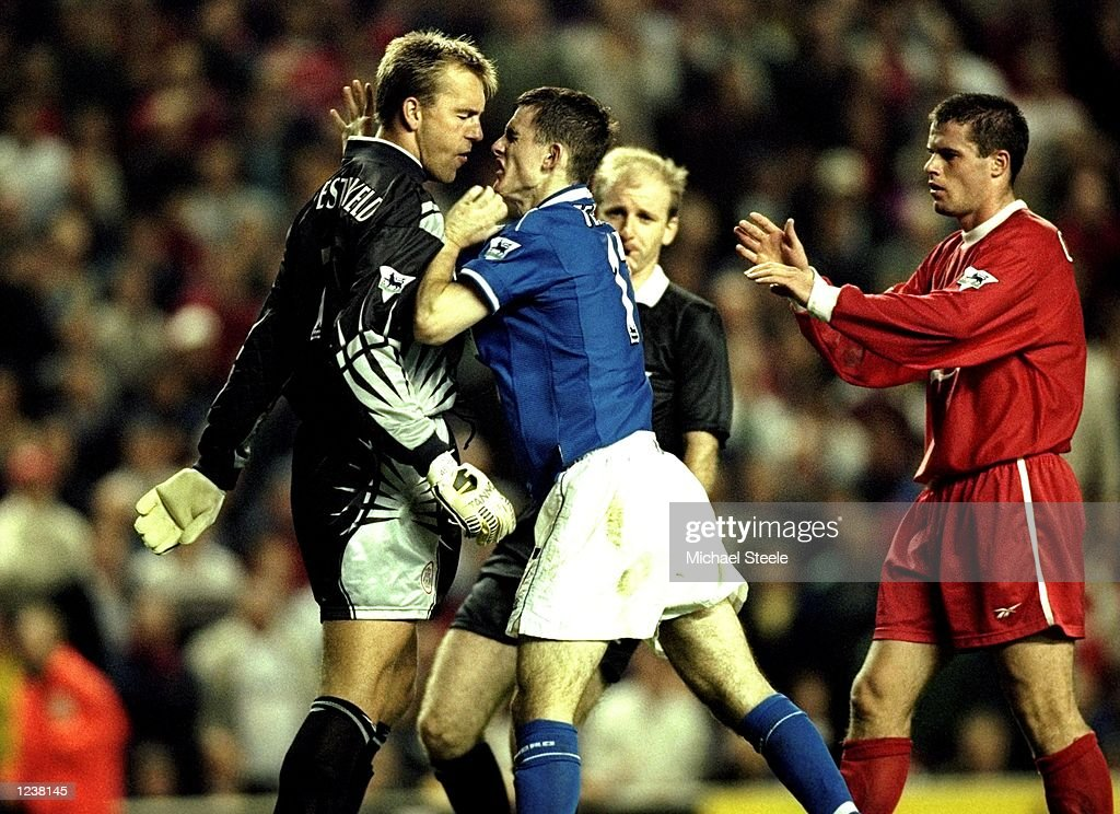 Sander Westerveld of Liverpool wrestles with Francis Jeffers of Everton during the FA Premier League match between Liverpool and Everton played at...