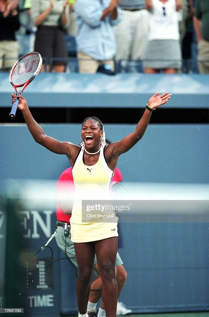 Serena Williams of the USA smiles and celebrates during the match between Martina Hingis of Switzerland in the US Open day 13 at the USTA National...