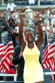 Serena Williams smiles and poses with her trophy after winning the US Open at the USTA National Tennis Courts in Flushing Meadows New York
