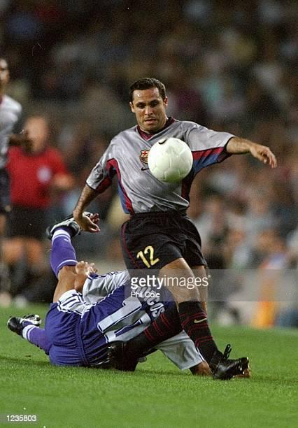 Sergi Barjuan of Barcelona beats Rui Costa of Fiorentina during the UEFA Champions League group B match at the Nou Camp in Barcelona Spain Barcelona...