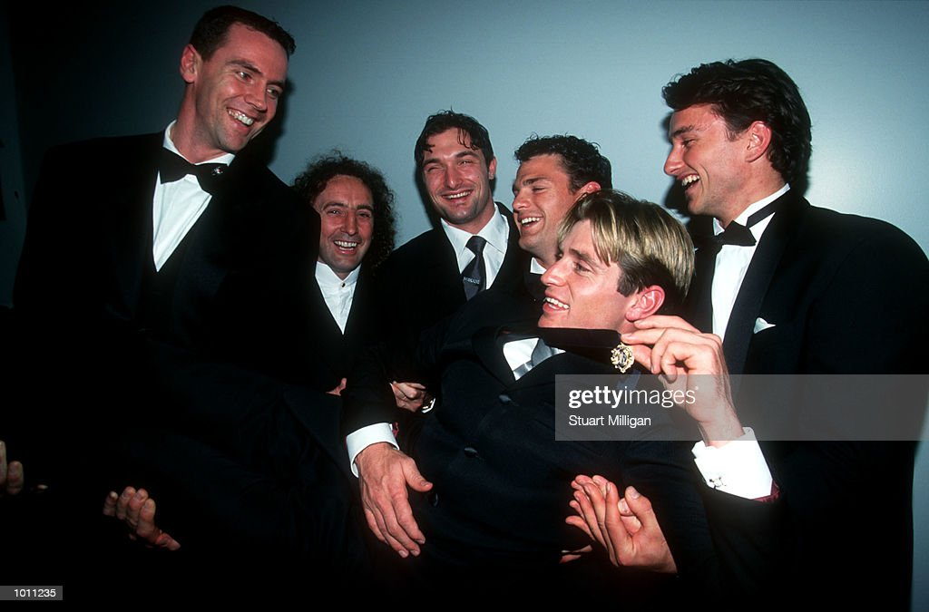 Shane Crawford of Hawthorn is congratulated by past and present Hawthorn players after winning the prestigious award at the Brownlow medal presentation night at the Horden Pavilion function centre,Moore Park Sydney Australia. Mandatory Credit: Stuart Milligan/ALLSPORT
