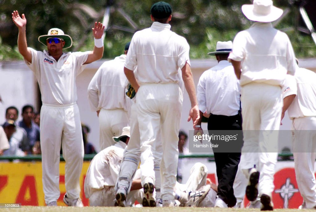Shane Warne calls for assistance after Jason Gillespie and Steve Waugh of Australia collided attempting a catch, during day two of the First Test between Sri Lanka and Australia at Asgiriya Stadium, Kandy, Sri Lanka. Mandatory Credit: Hamish Blair/ALLSPORT