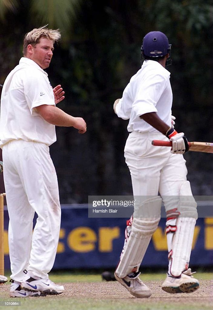Shane Warne (left) of Australia exchanges words with Pradeep Hewage of the Board XI after they collided mid pitch, during day three of the tour match between the Sri Lanka Board XI and Australia at Saravanamuttu Stadium, Colombo, Sri Lanka.Mandatory Credit: Hamish Blair/ALLSPORT