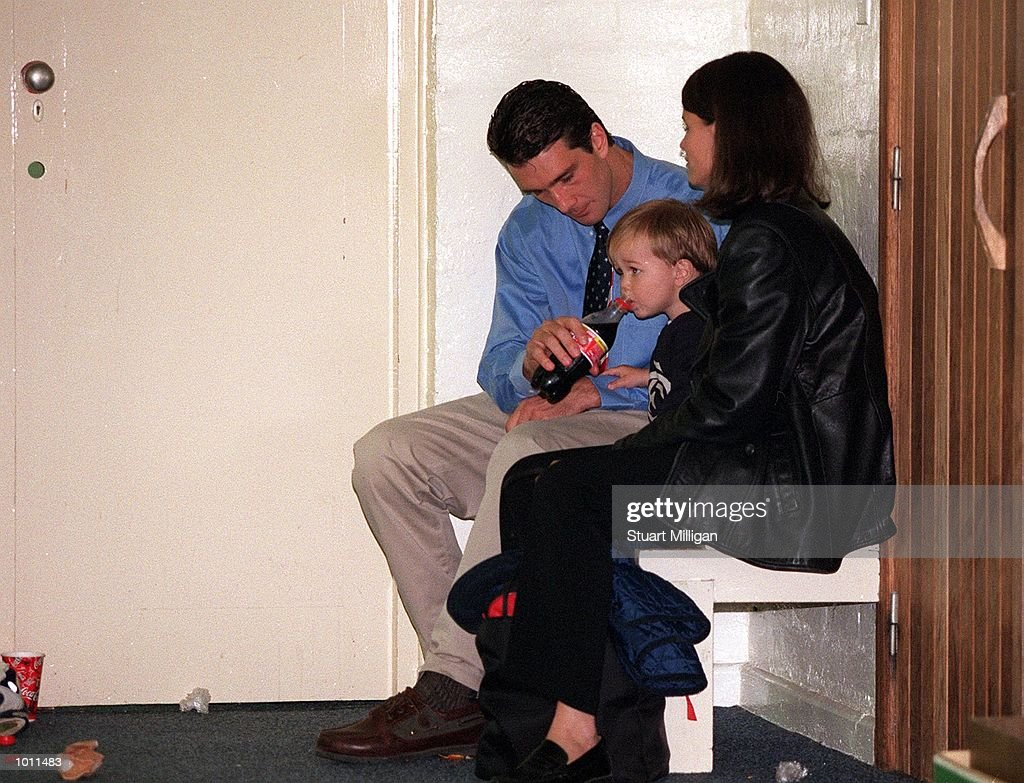 Stephen Silvagni #1 for Carlton sits with wife Jo and son Jack in the rooms after Carlton's loos, in the AFL Grand Final match between the Kangaroos and Carlton, played at the Melbourne Cricket Ground, Melbourne, Australia. The Kangaroos defeated Carlton. Mandatory Credit: Stuart Milligan/ALLSPORT